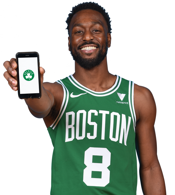 Kemba Walker holding a phone with the Celtics App