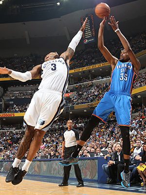 Kevin Durant takes a shot over James Johnson.