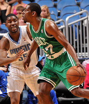 Jordan Crawford drives on E'Twaun Moore