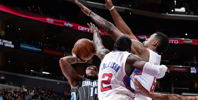 DeAndre Jordan and Darren Collison go up for the block