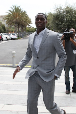 Photo of Darren Collison wearing a suit.