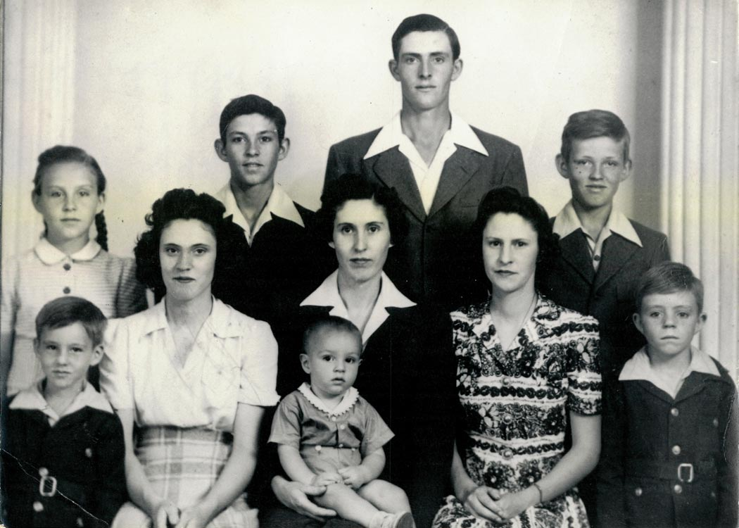 An infant Jerry Sloan with his 9 siblings.