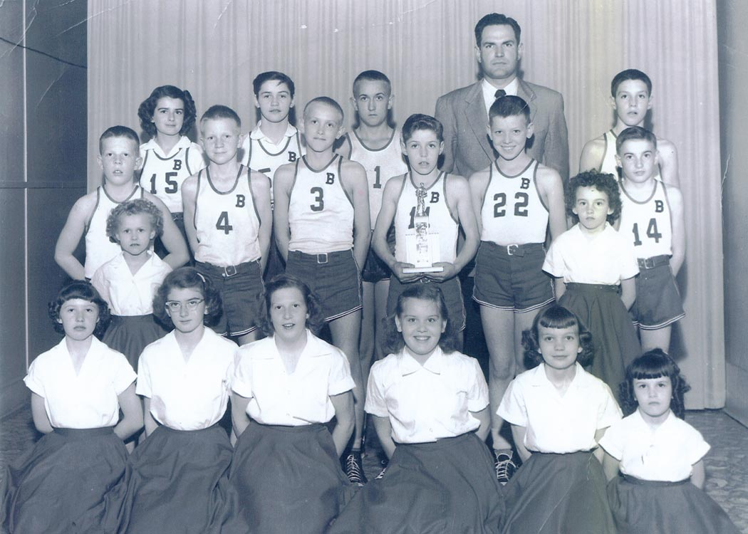 A young Jerry Sloan posing with a youth sports team.