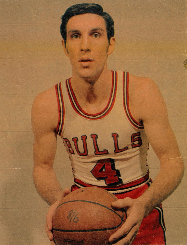 A young Jerry Sloan wearing a Chicago Bulls jersey.