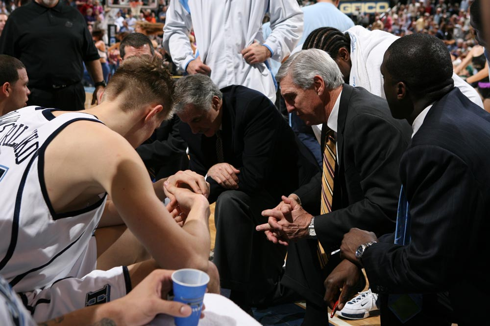 Jerry Sloan huddles with the Utah Jazz.
