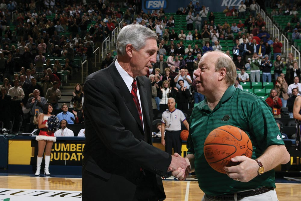 Jerry Sloan shakes hands with Larry Miller.