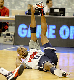 Kobe Bryant stretches before a Team USA practice