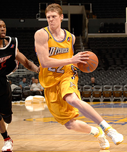 Coby Karl #22 of the Los Angeles D-Fenders drives to the basket against CJ Watson #32 of the Rio Grande Valley Vipers at Staples Center November 29, 2007
