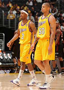 Lawrence McKenzie #2 and Dwayne Mitchell #50 of the Los Angeles D-Fenders take a break from the action during the D-League against the Utah Flash game on April 5, 2009