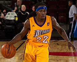 Courtney Fortson dribbles