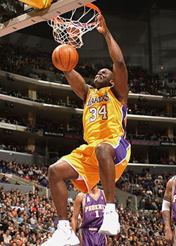 Shaquille O'Neal dunks during a game against the Phoenix Suns.