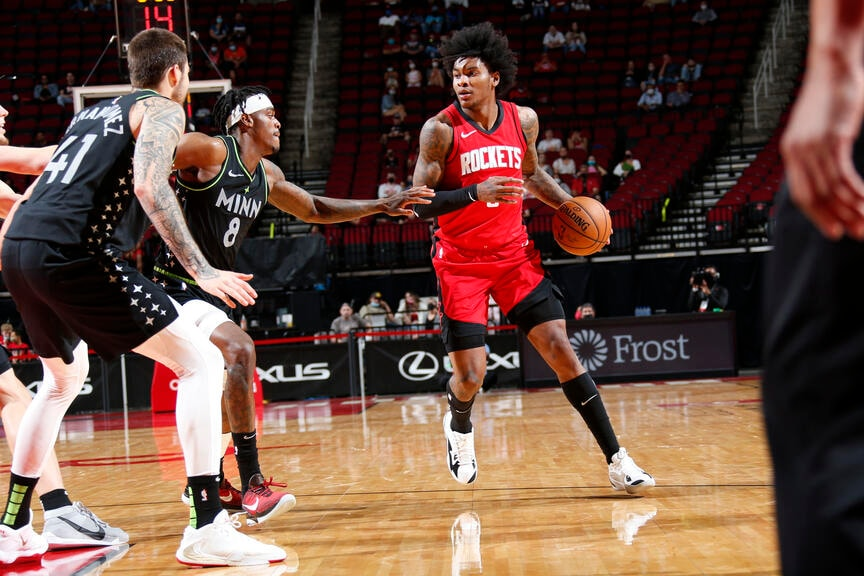 HOUSTON, TX - APRIL 27: Kevin Porter Jr. #3 of the Houston Rockets drives to the basket during the game against the Minnesota Timberwolves on April 27, 2021 at the Toyota Center in Houston, Texas. (Troy Fields/NBAE via Getty Images)