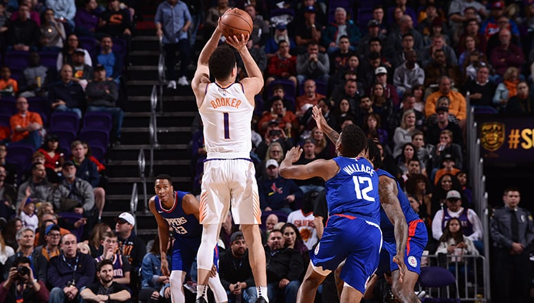 Booker and Warren Combine for 54 in Loss to Clippers
