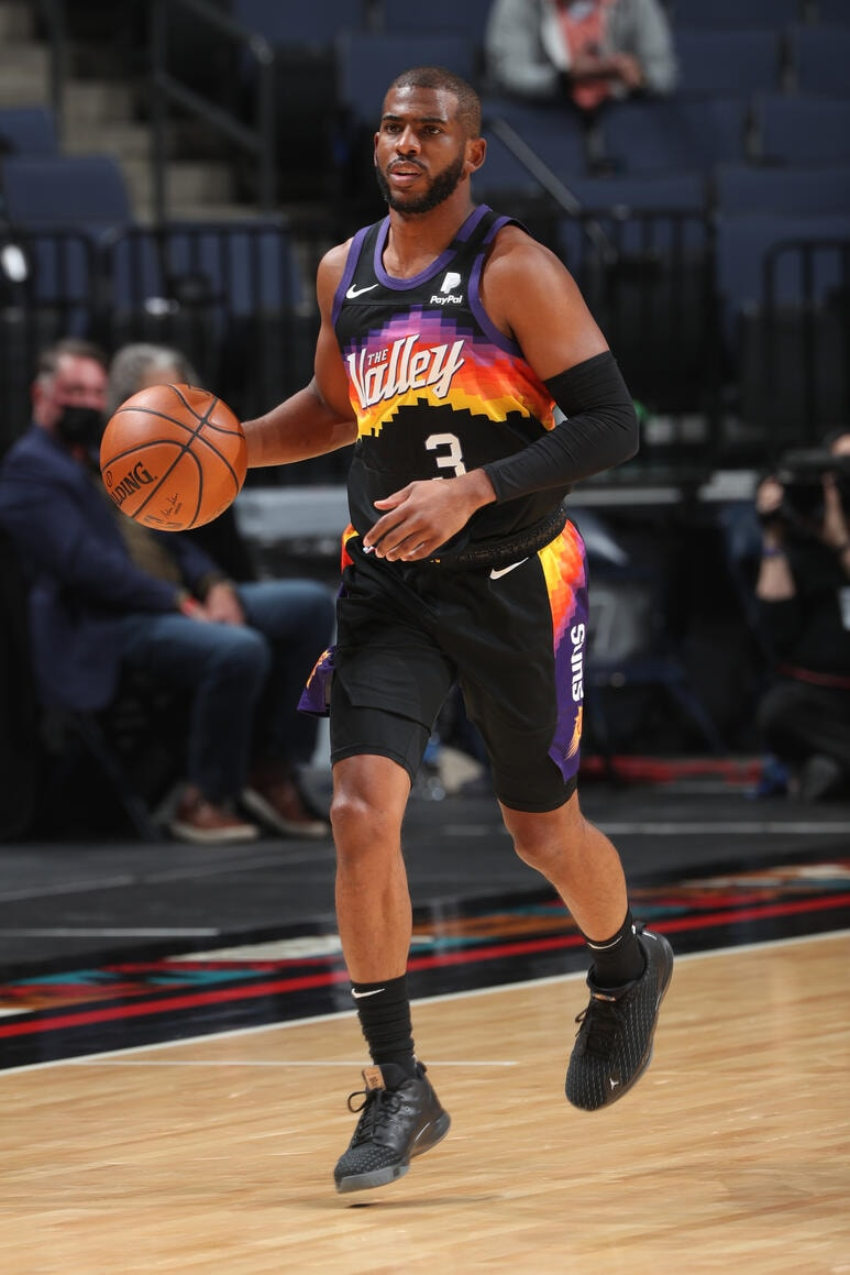 MEMPHIS, TN - FEBRUARY 20: Chris Paul #3 of the Phoenix Suns handles the ball during the game against the Memphis Grizzlies on February 20, 2021 at FedExForum in Memphis, Tennessee. (Joe Murphy/NBAE via Getty Images)