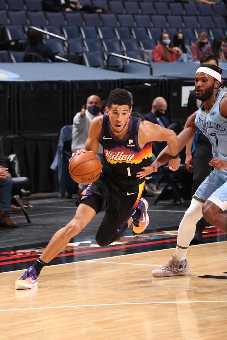 MEMPHIS, TN - FEBRUARY 20: Devin Booker #1 of the Phoenix Suns handles the ball during the game against the Memphis Grizzlies on February 20, 2021 at FedExForum in Memphis, Tennessee. (Joe Murphy/NBAE via Getty Images)