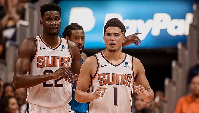 Booker Catches Fire in Suns Victory Ayton Shines in Debut