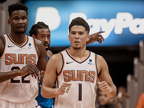 Booker Catches Fire in Suns Victory, Ayton Shines in Debut