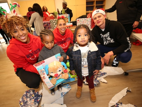 Wizards, Mystics, and MSE Foundation bring holiday cheer with annual Family-to-Family event