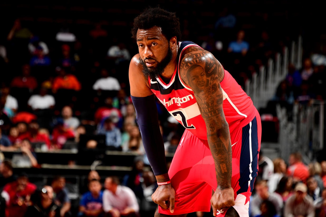Wall's 32 points power Wizards past Pistons