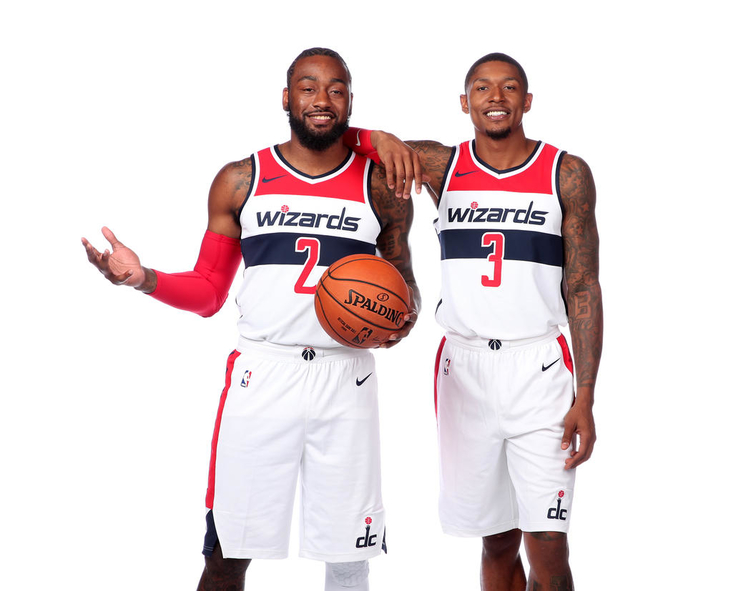 WASHINGTON, DC - SEPTEMBER 24 John Wall 2 and Bradley Beal 3 of the Washington  Wizards pose for a portrait during media day at the Entertainment and ...