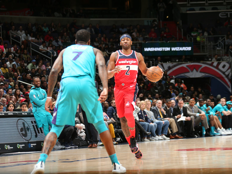 Wizards clinch playoff berth in Wall's return, 107-93